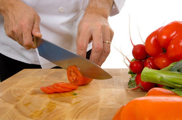 Why is a well-designed kitchen so important to food safety